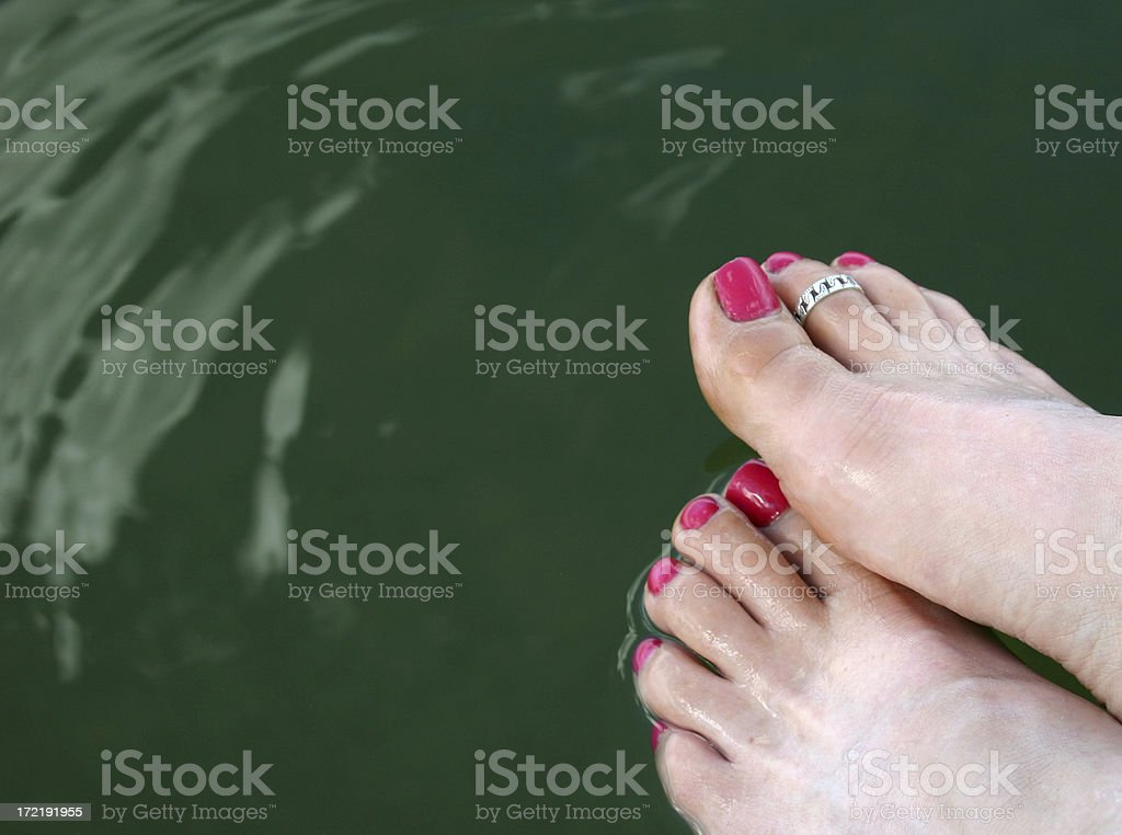 Hot Pink Toes in Lake royalty-free stock photo