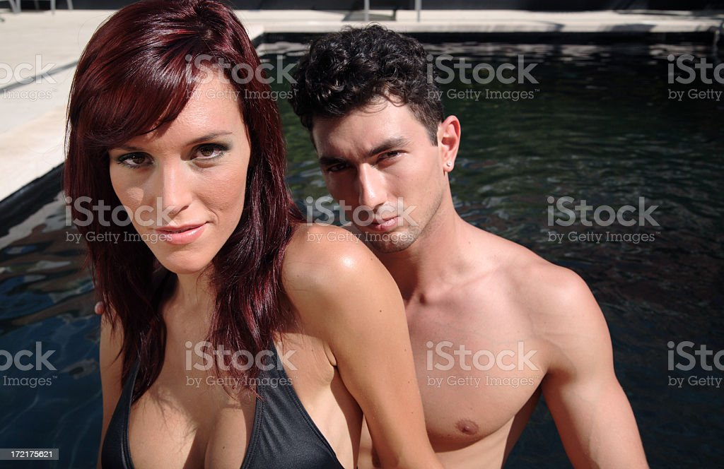 Hot poolside couple. royalty-free stock photo
