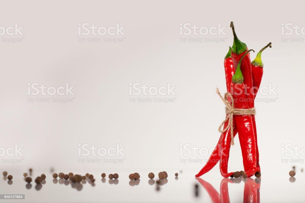 Hot red chilly peppers with pea-coals stock photo