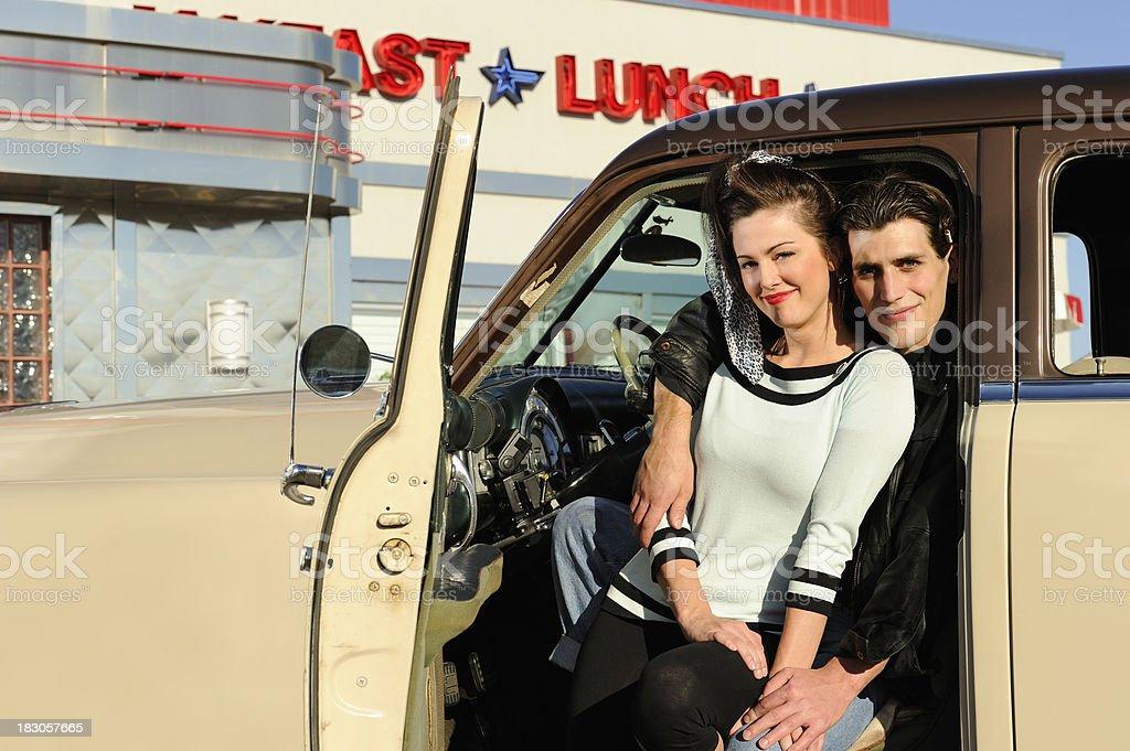 Hot Retro 50's Couple Sitting In Car Door Frame stock photo