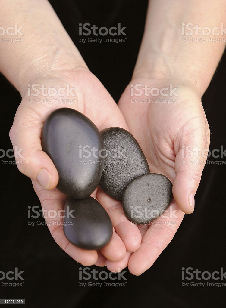 Hot Rocks in Hands royalty-free stock photo