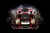 Hot rod front view with smoke burnout background