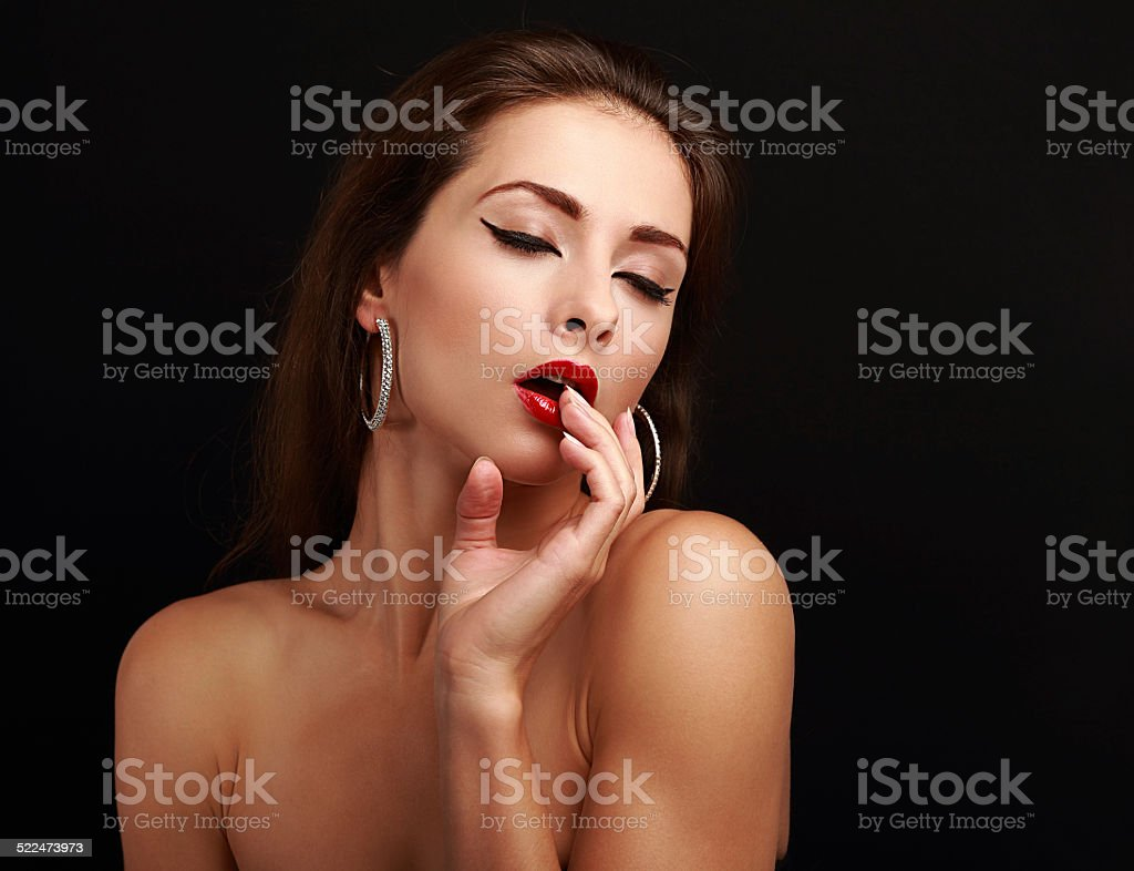 Hot sexy exciting woman with hand near red lips stock photo