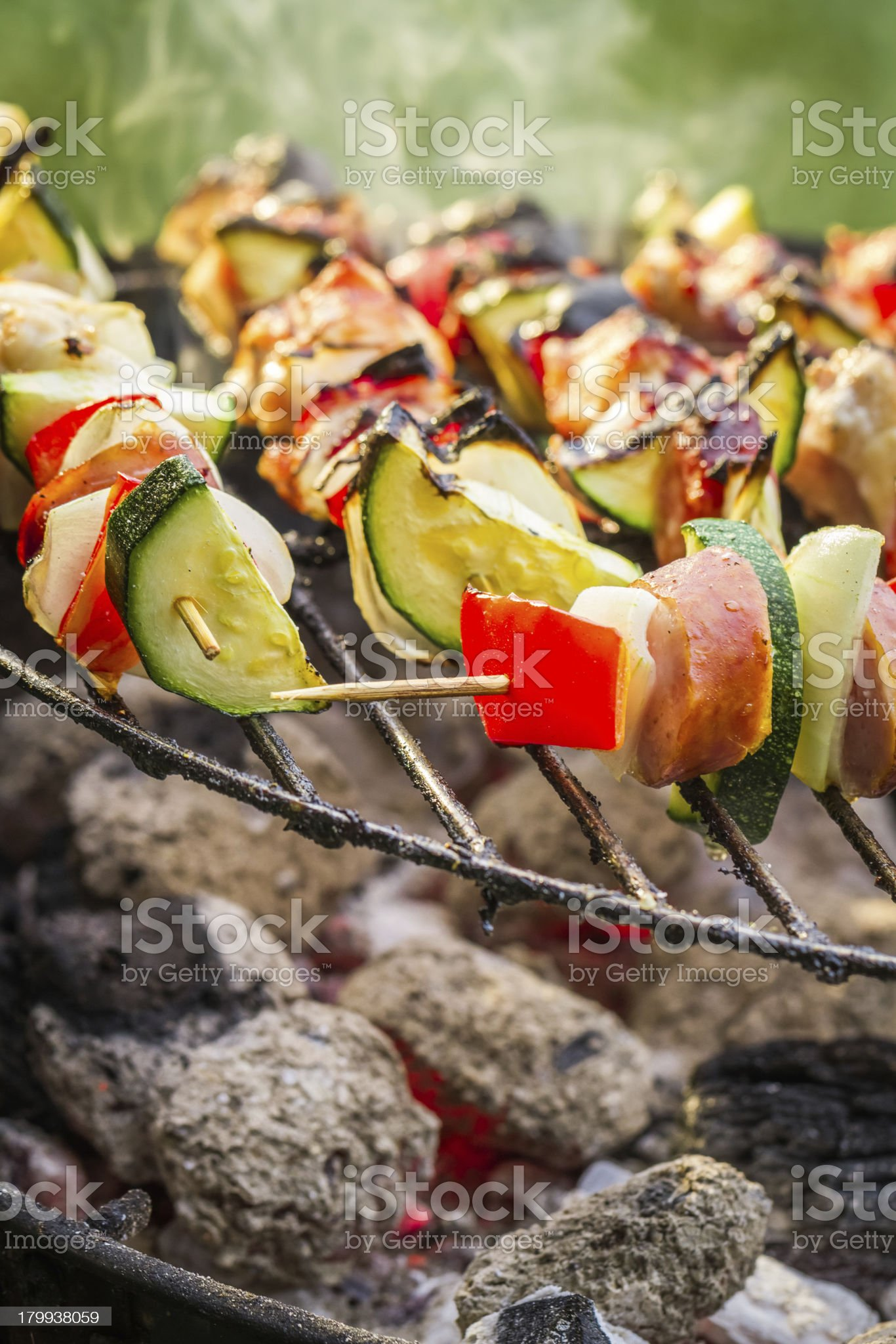 Hot skewers on the grill with fire royalty-free stock photo