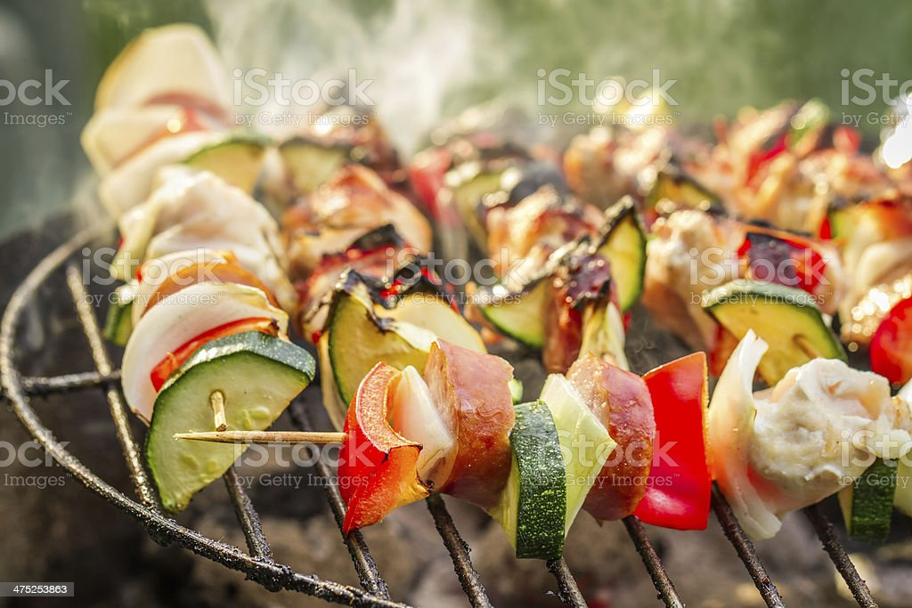 Hot skewers on the grill with fire stock photo