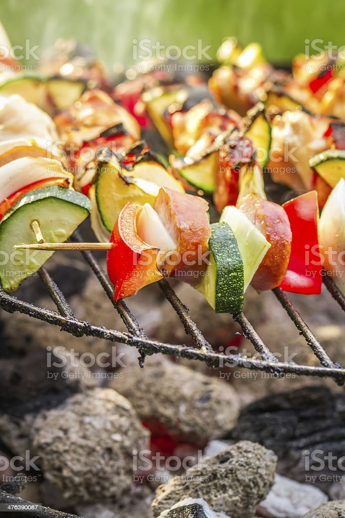 Hot skewers with vegetables on the grill royalty-free stock photo