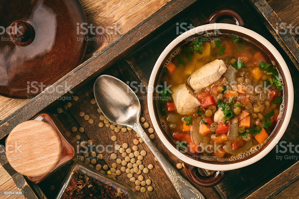 Hot soup with green lentil, chicken, vegetables and spices. stock photo