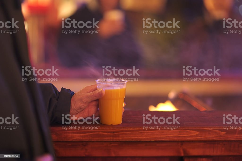 Hot spiced drink at outdoors wood fire royalty-free stock photo