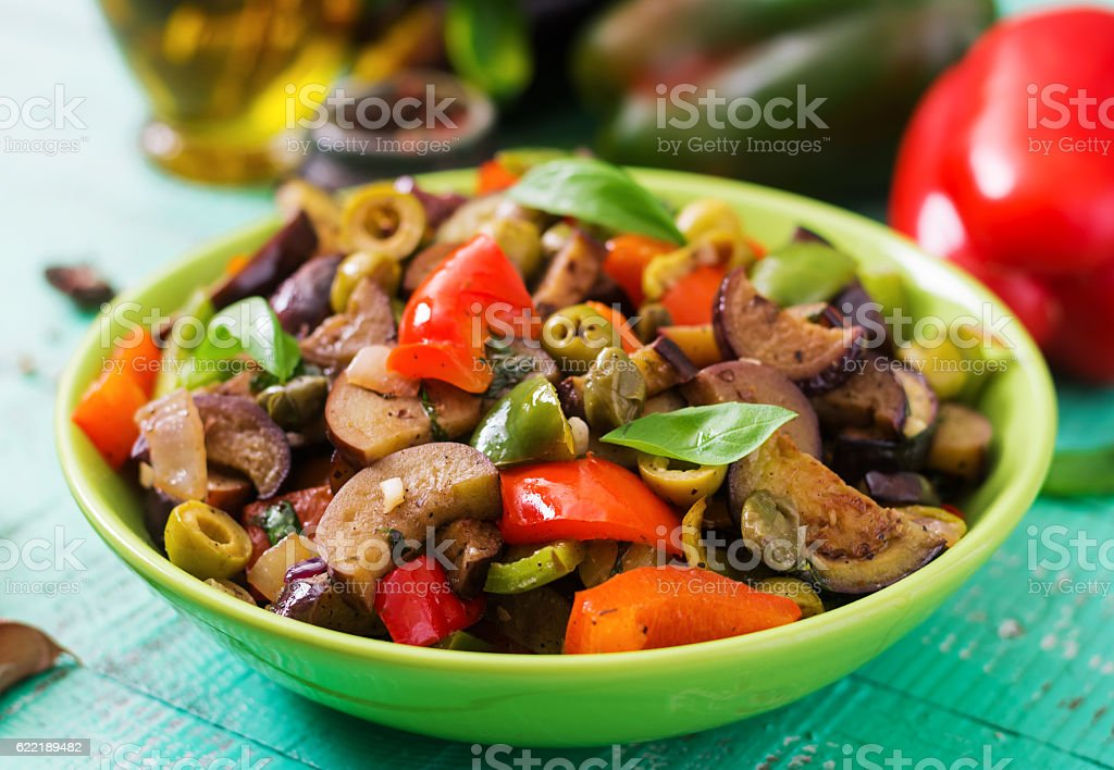 Hot spicy stew eggplant, sweet pepper, olives and capers stock photo