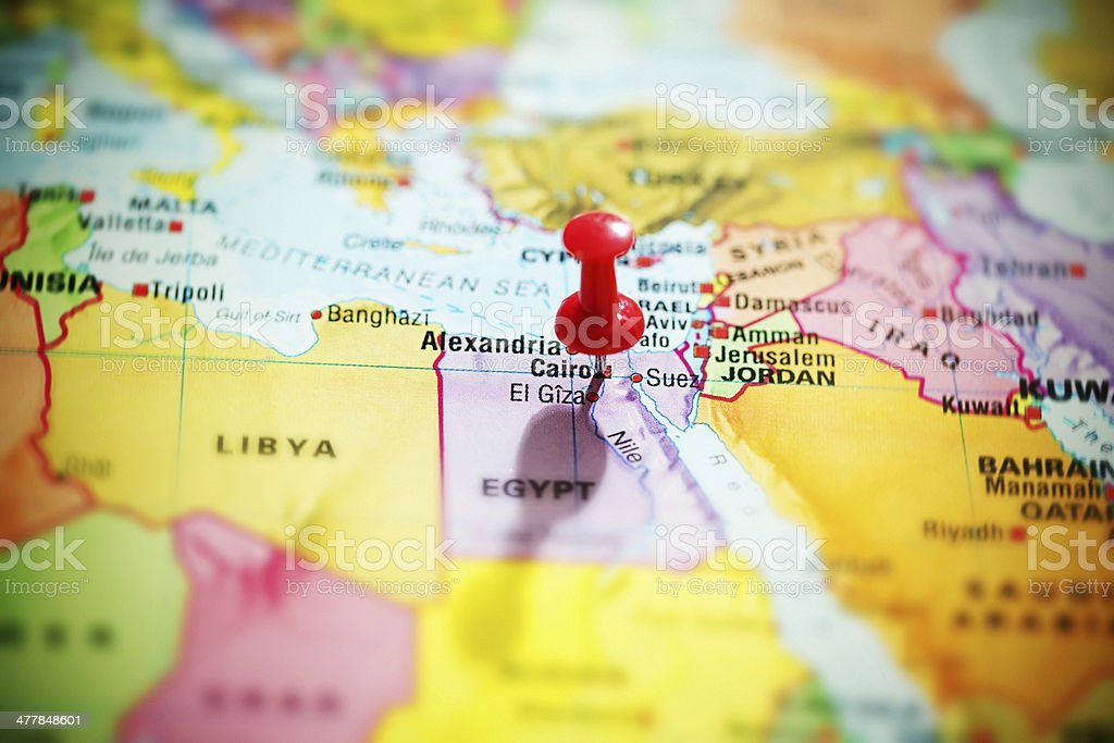 Hot spot! Red thumbtack marks Cairo, Egypt, on map royalty-free stock photo