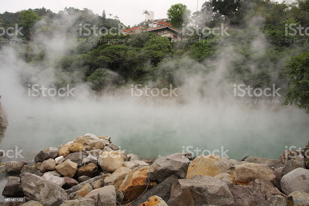 Hot spring with large fog and rocks royalty-free stock photo