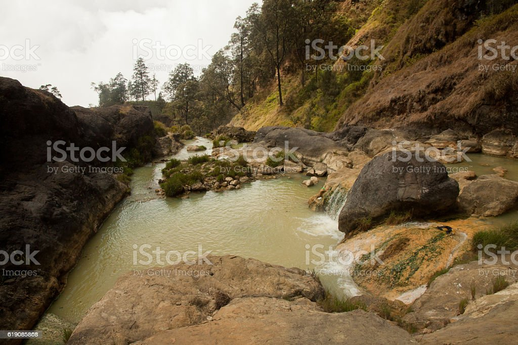 Hot springs with yellow water at Mount Rinjani volcano, Lombok stock photo