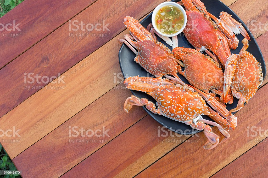 Hot Steamed Blue Crabs on the black plate stock photo