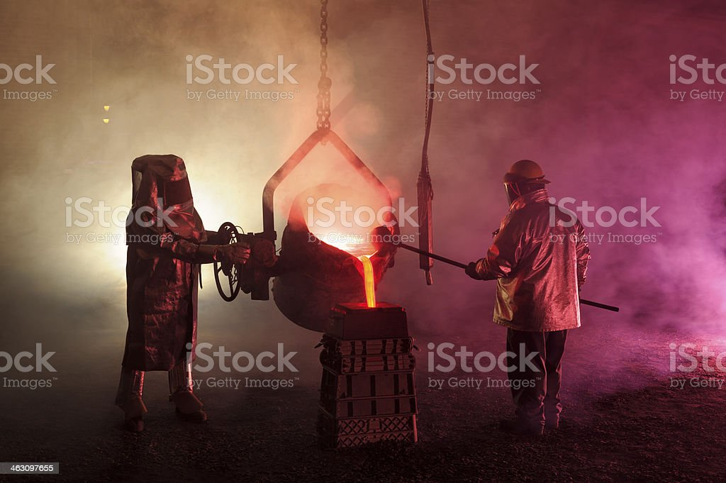 Hot Steel Mill Pour Reenactment, Metalurgical Workers with Ladle stock photo