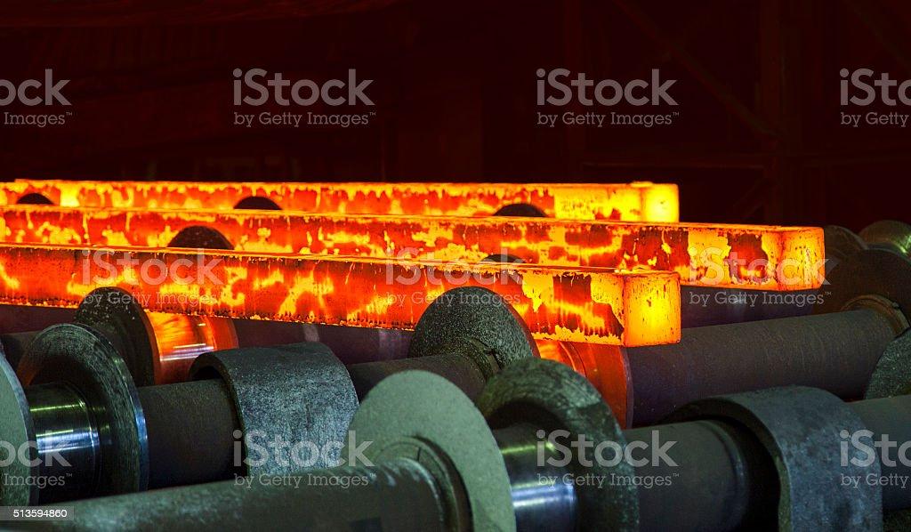 hot steel on conveyor stock photo