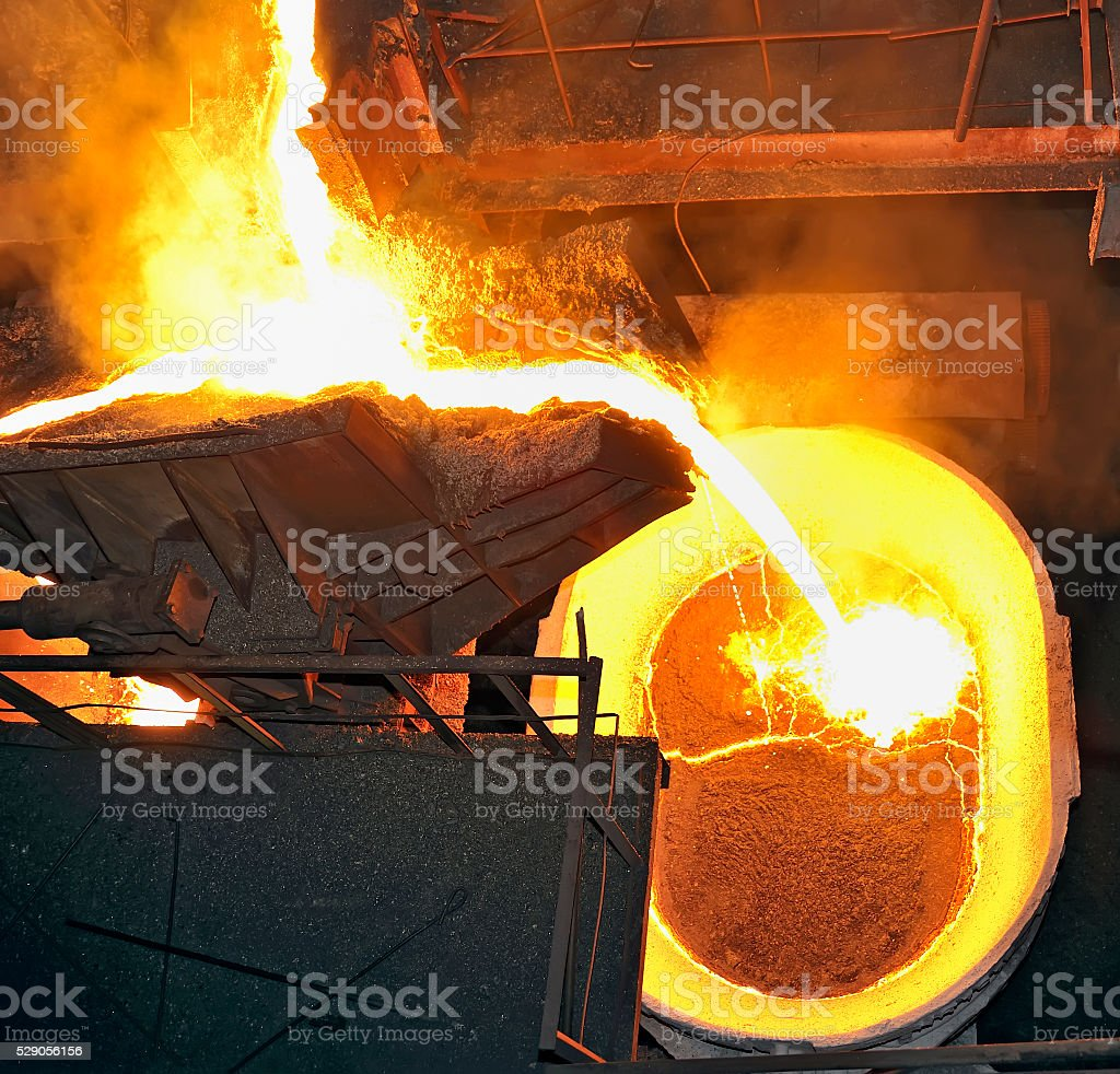 Hot steel pouring stock photo
