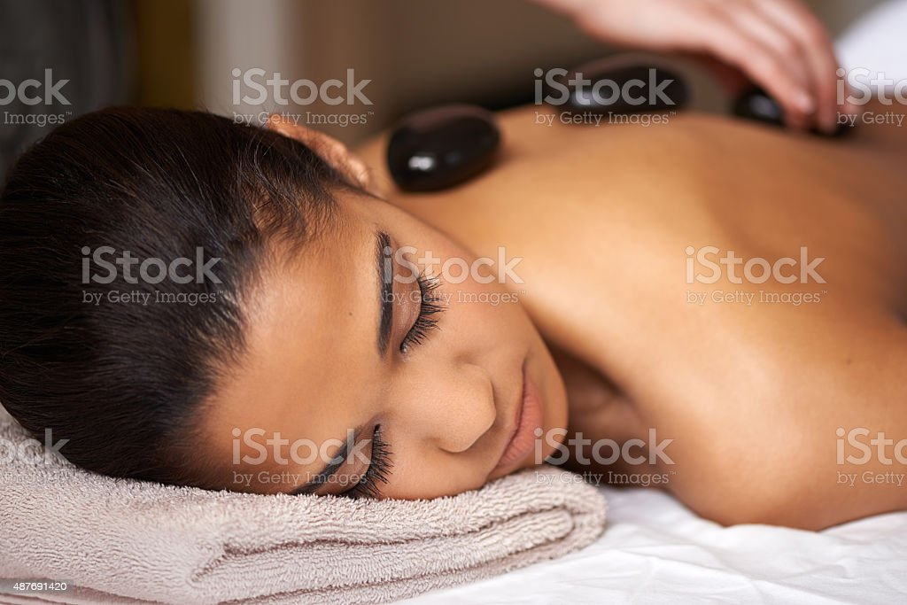 Hot stone healing stock photo