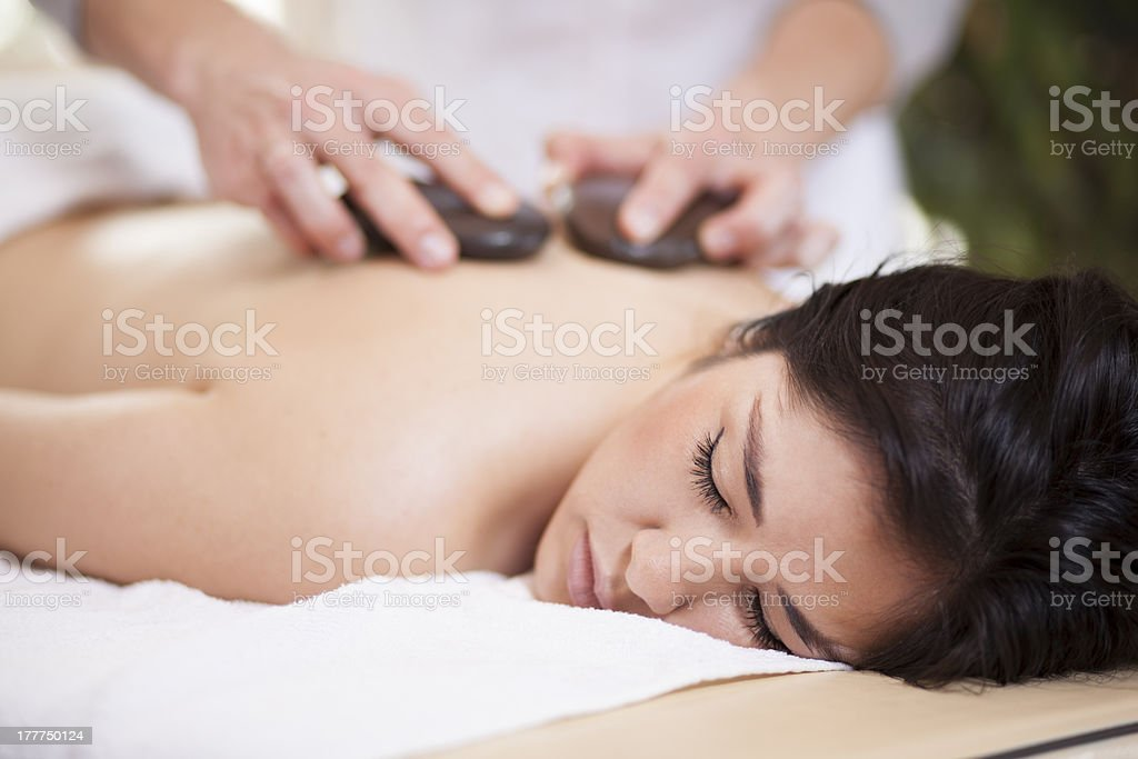 Hot stone massage at a health spa royalty-free stock photo