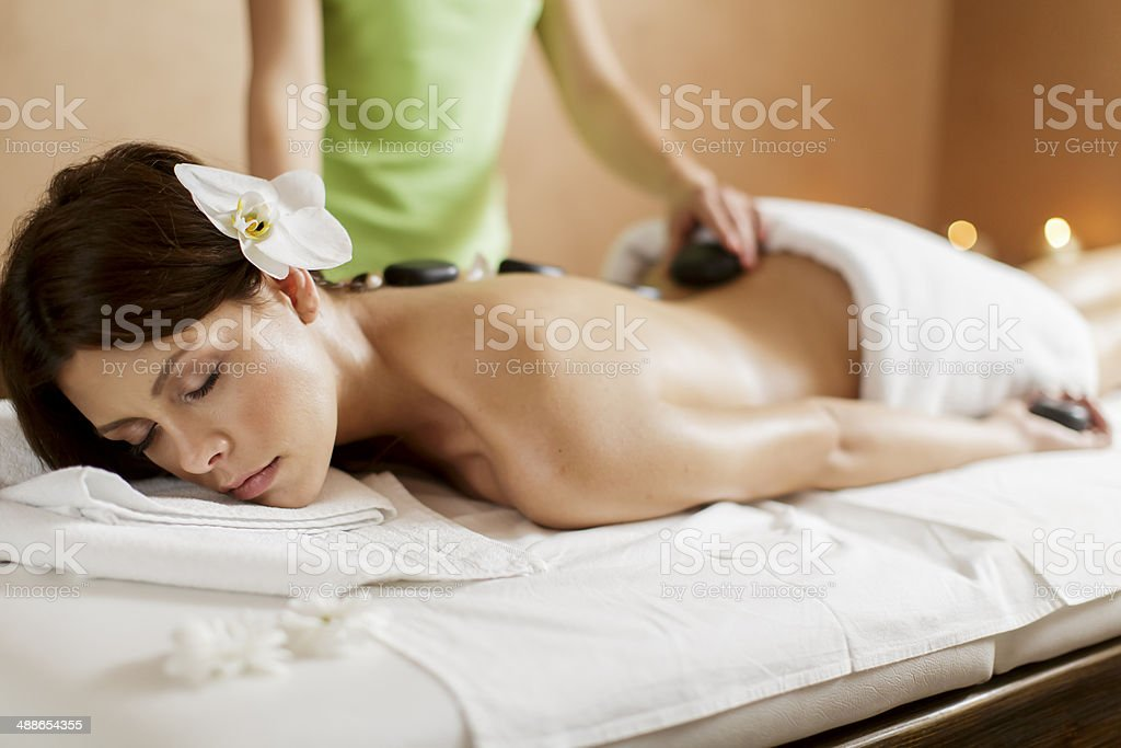 Hot stone massage therapy stock photo