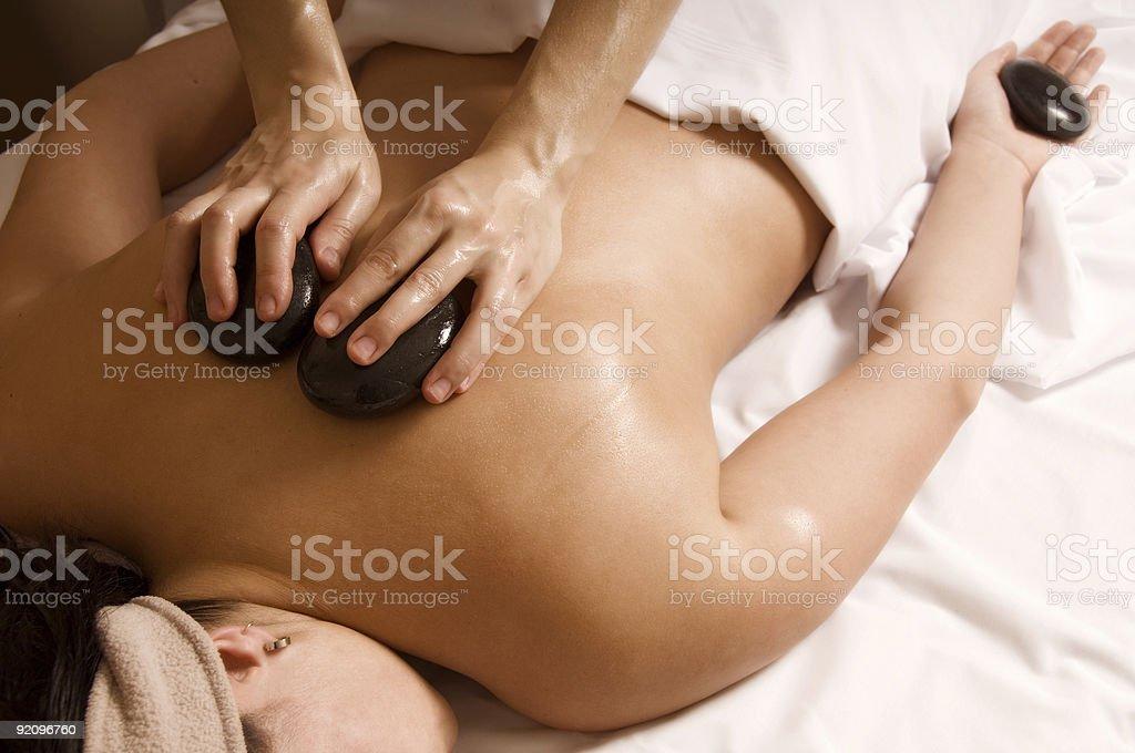Hot stone massage with black rocks royalty-free stock photo
