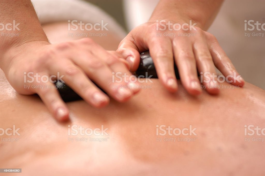 Hot stone massaging stock photo