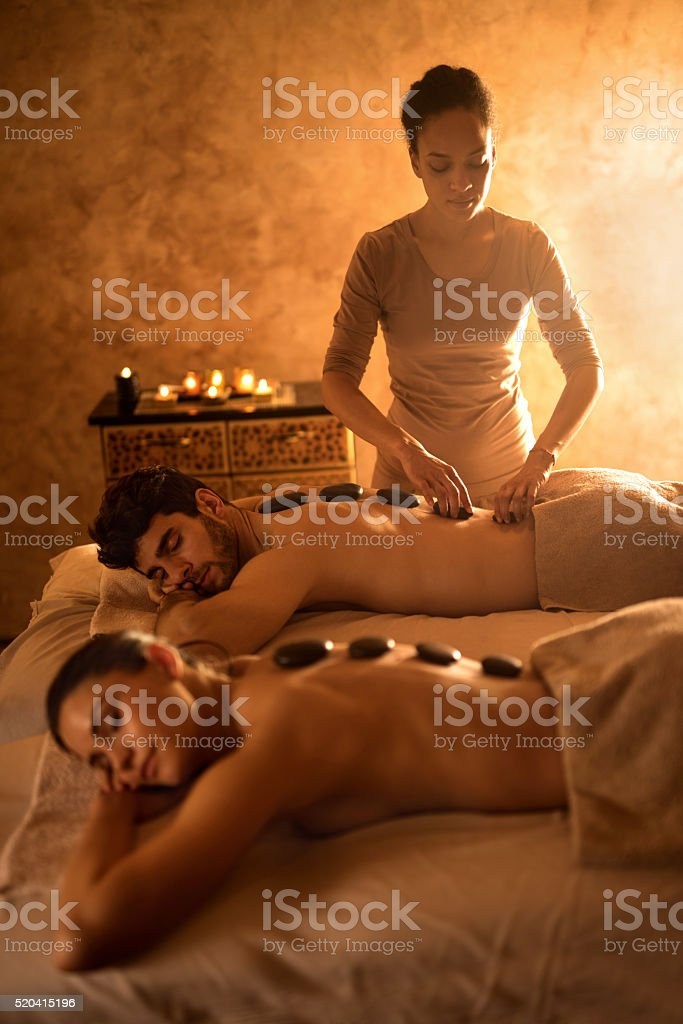 Hot stone therapy at the spa. stock photo