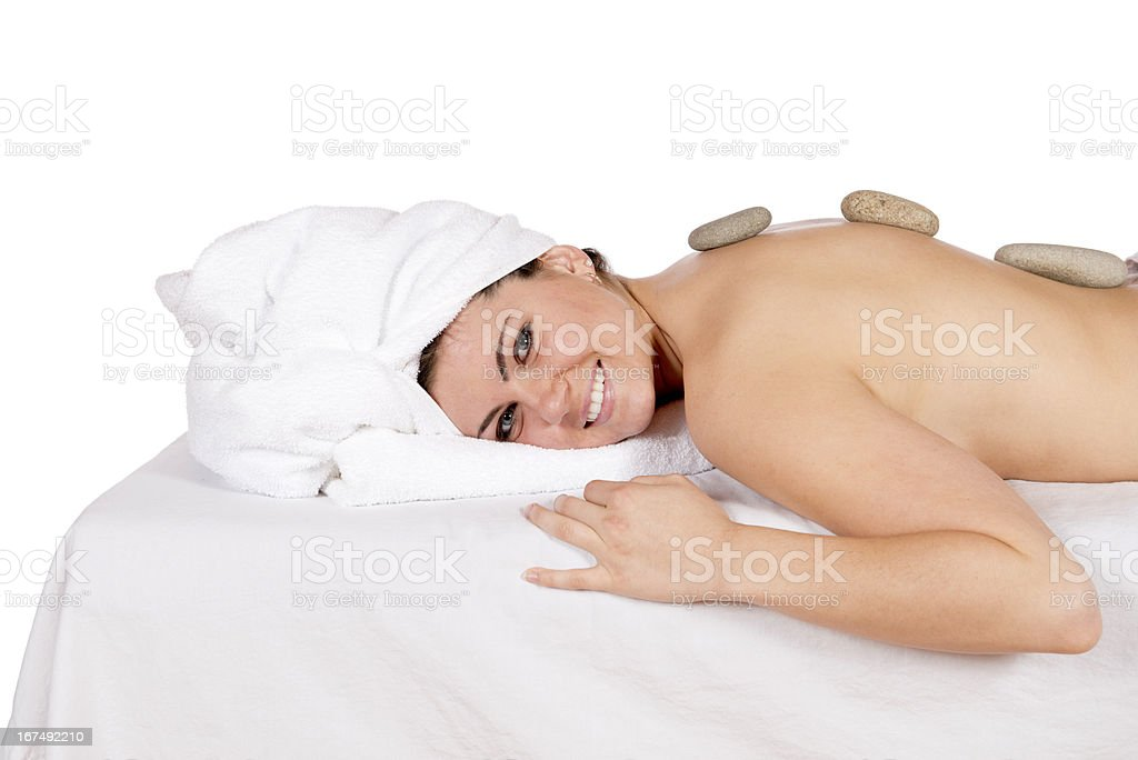 Hot stone therapy hydrating oils at day spa royalty-free stock photo