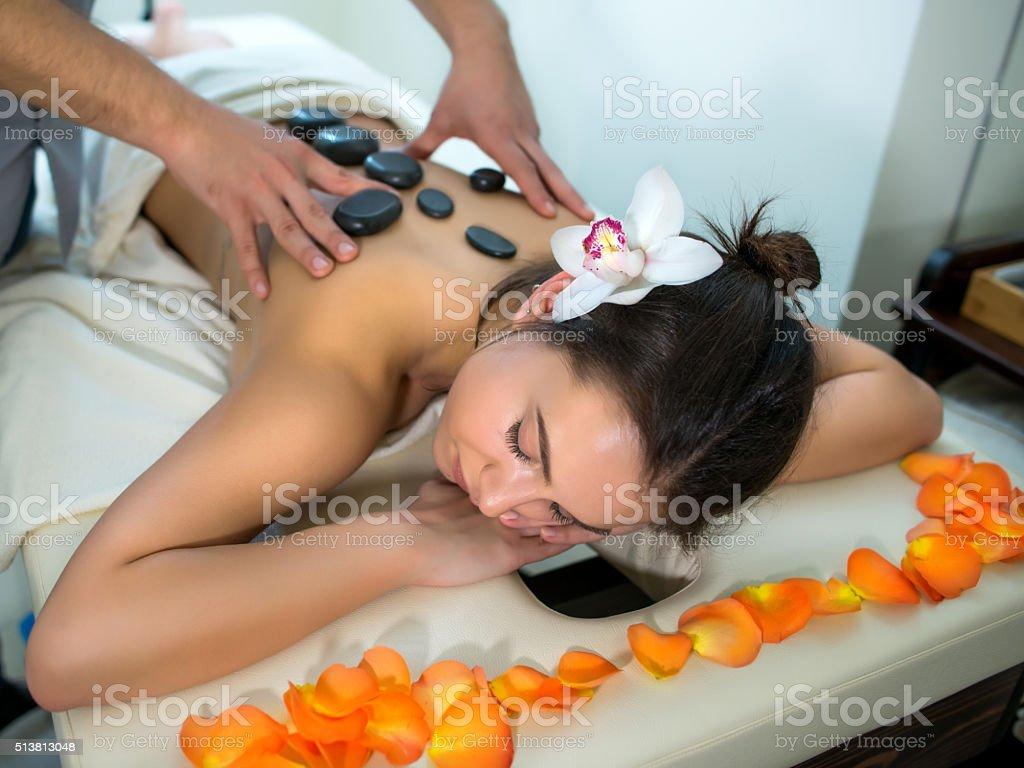 Hot stone therapy massage stock photo