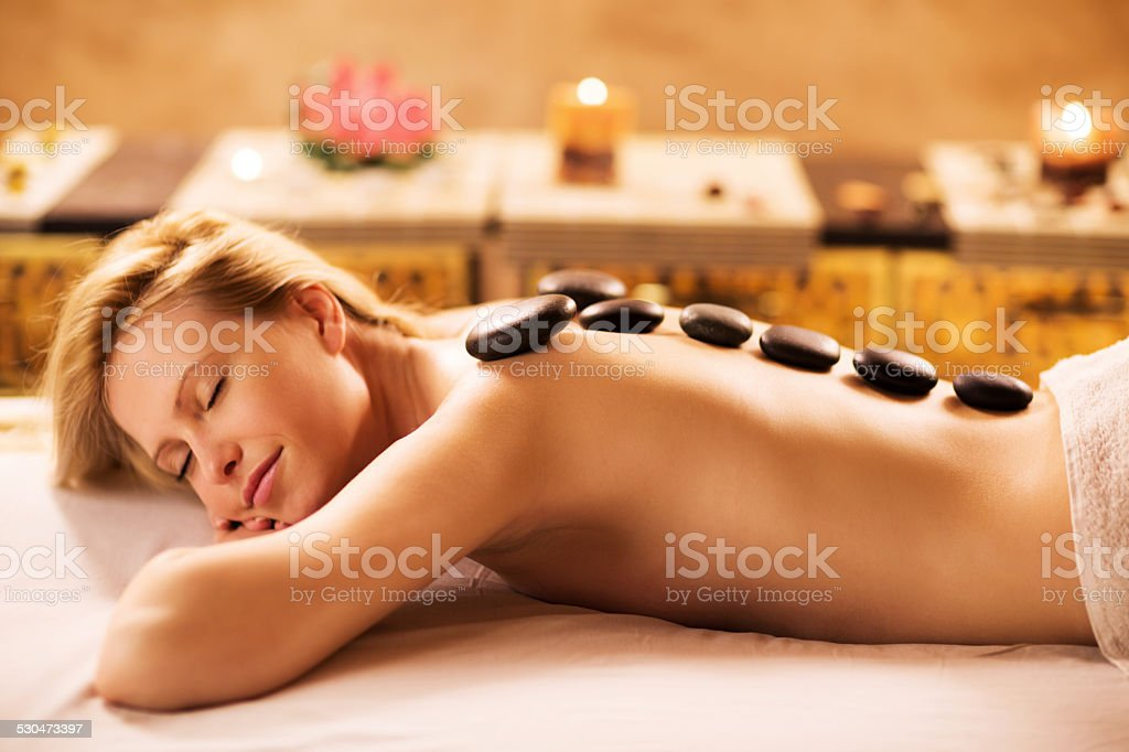 Hot stone therapy. stock photo
