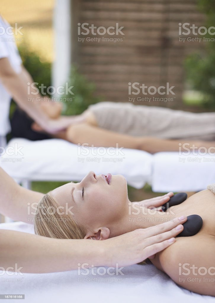 Hot stone therapy relaxes like nothing on earth royalty-free stock photo