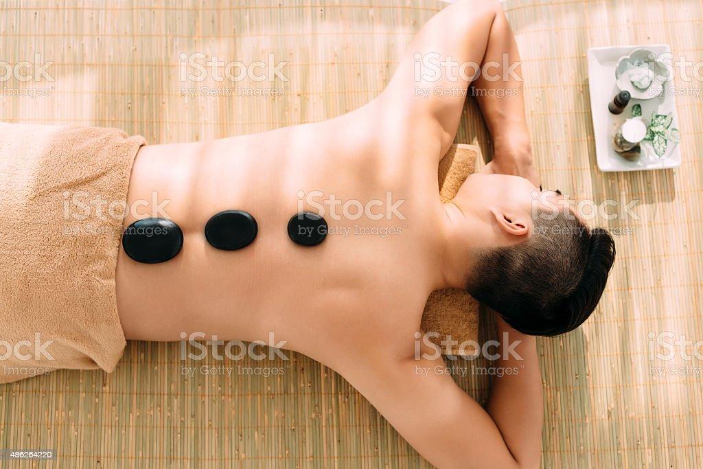Hot stones massage stock photo