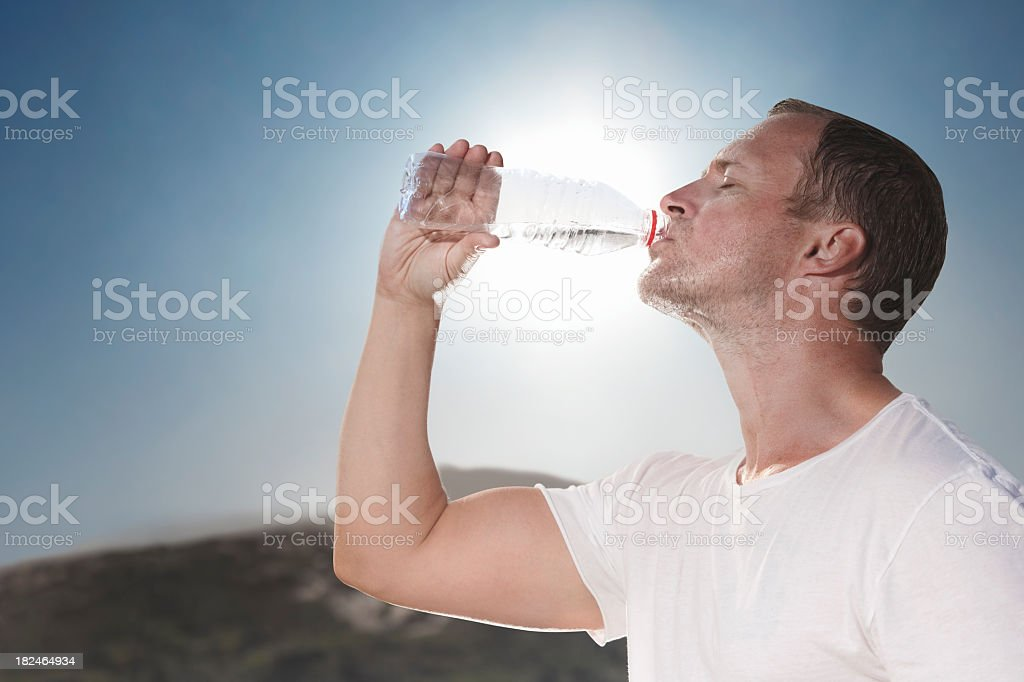 Hot sunny day drinking water from a bottle stock photo