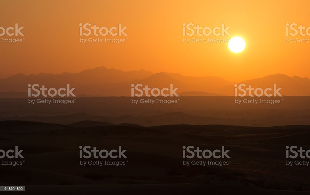 Hot sunrise in the desert dunes of Dubai, United Arab Emirates. stock photo