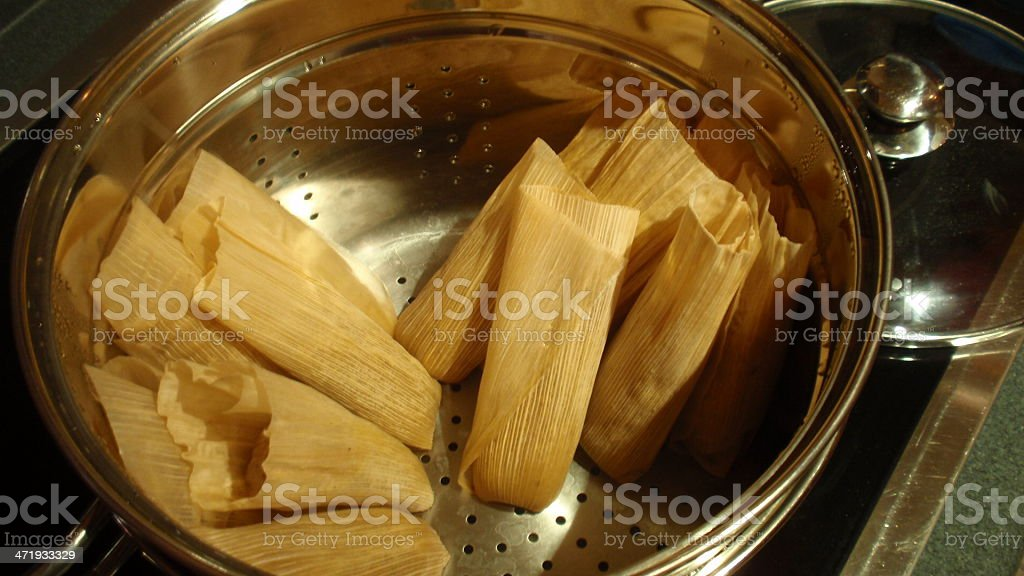 Hot tamales cooking in pot on stove stock photo
