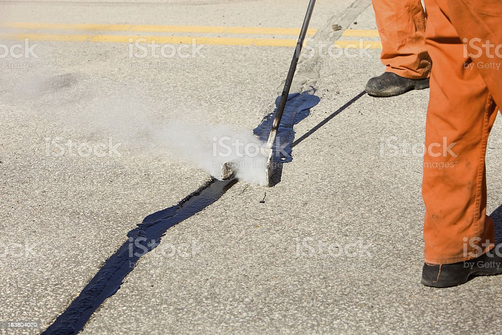 Hot Tar Asphalt Road Crack Repair stock photo