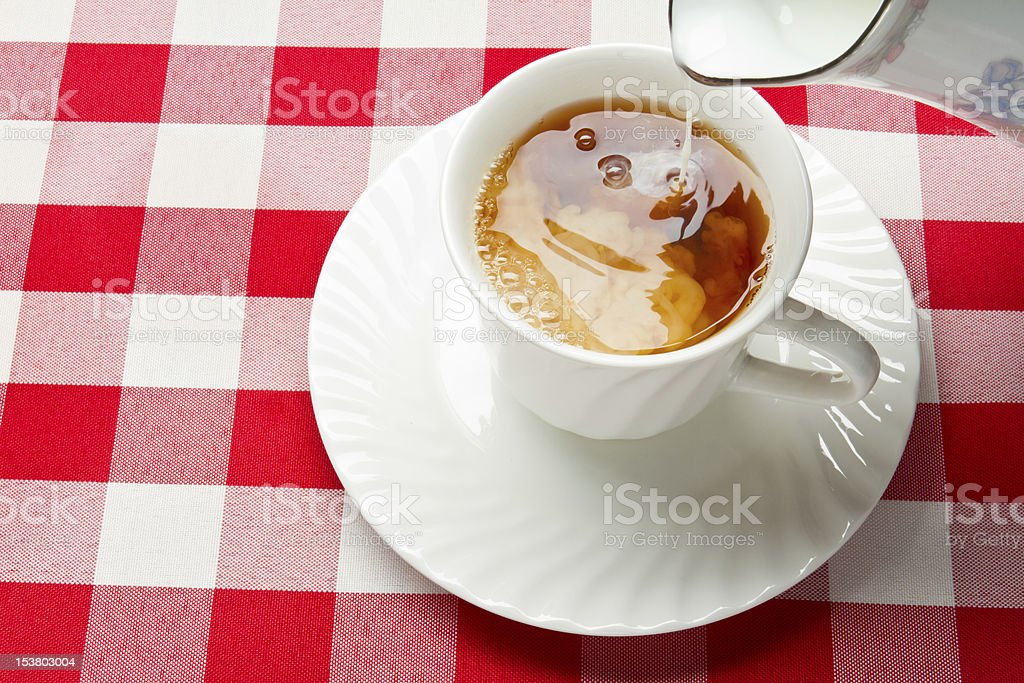 Hot Tea and Milk in a White Teacup stock photo