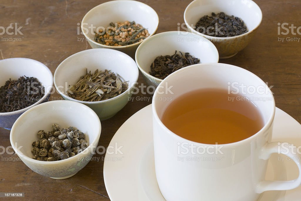 Hot Tea in Cup Near Leaf Varieties for Tasting Selections stock photo