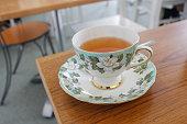Hot tea in floral porcelain cup