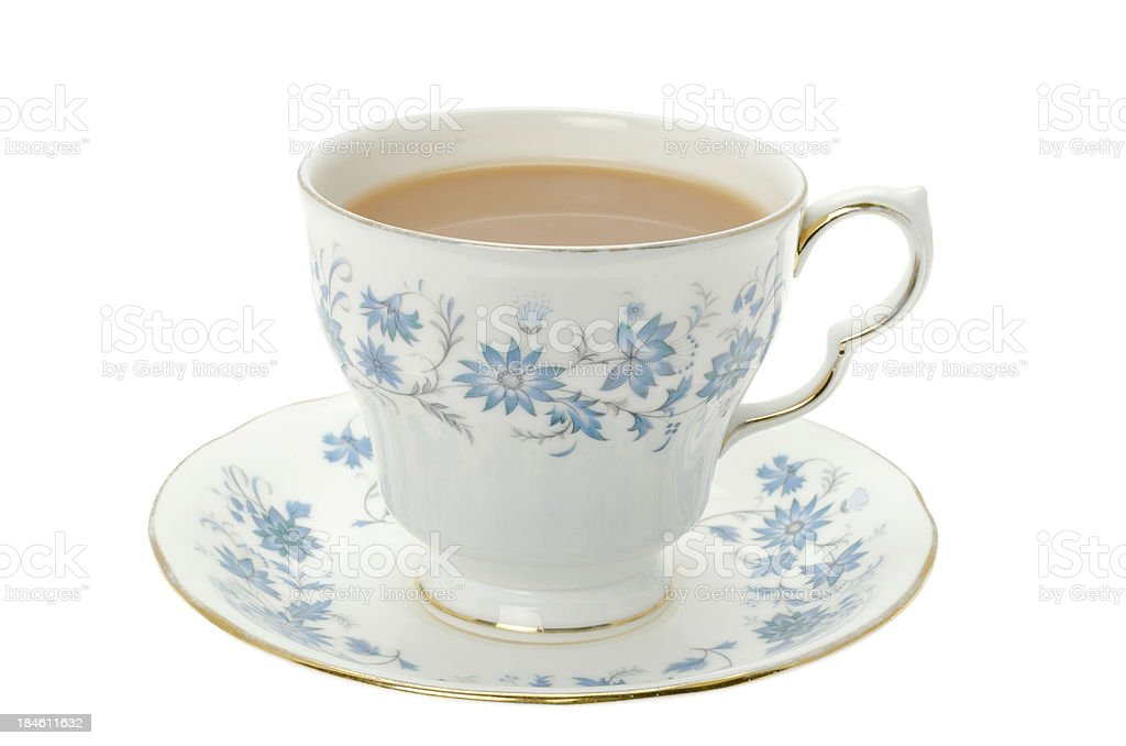 Hot tea served in a bone china cup and saucer stock photo