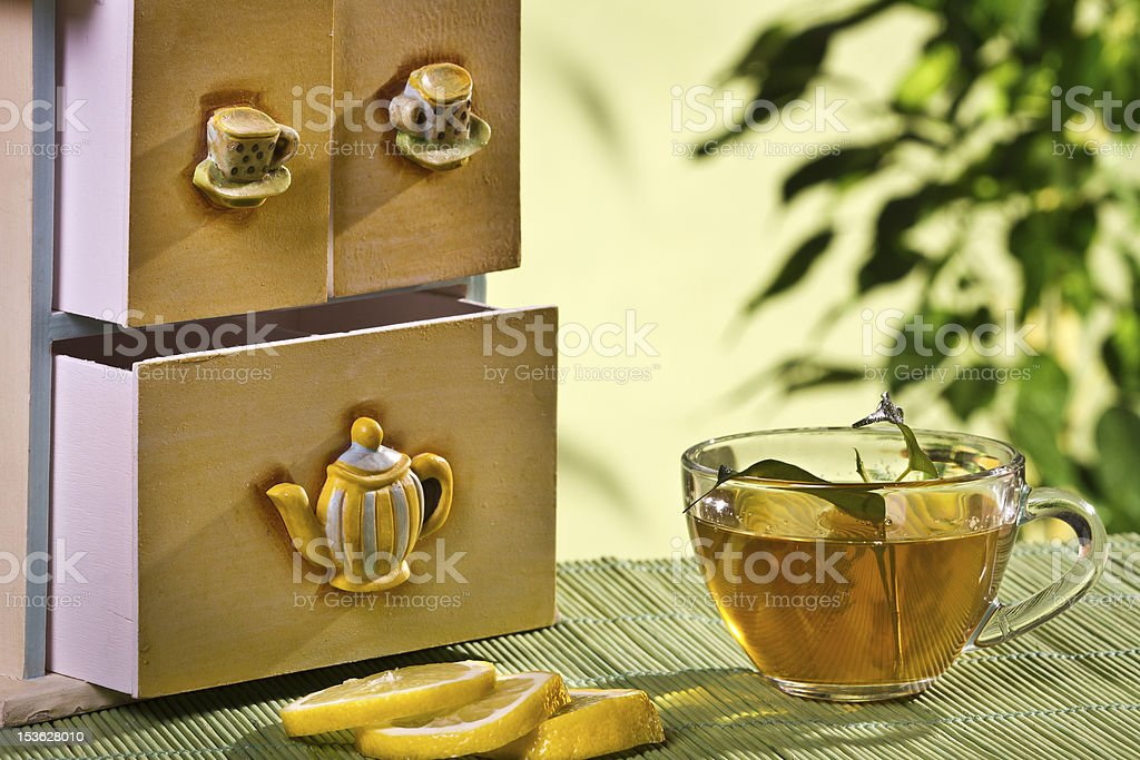 Hot tea with cupboard and lemon royalty-free stock photo