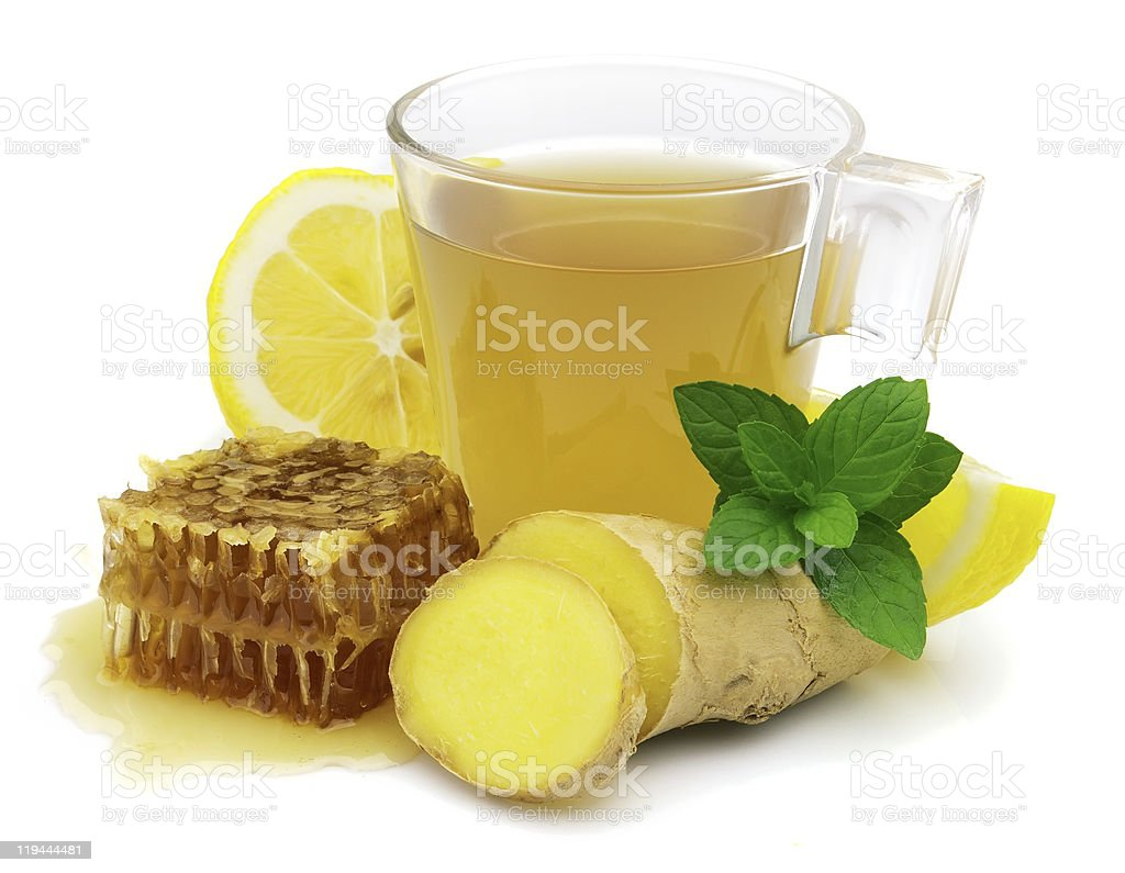 Hot tea with fresh ginger, lemon and honeycomb royalty-free stock photo