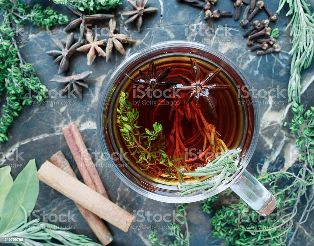 Hot tea with herbs stock photo