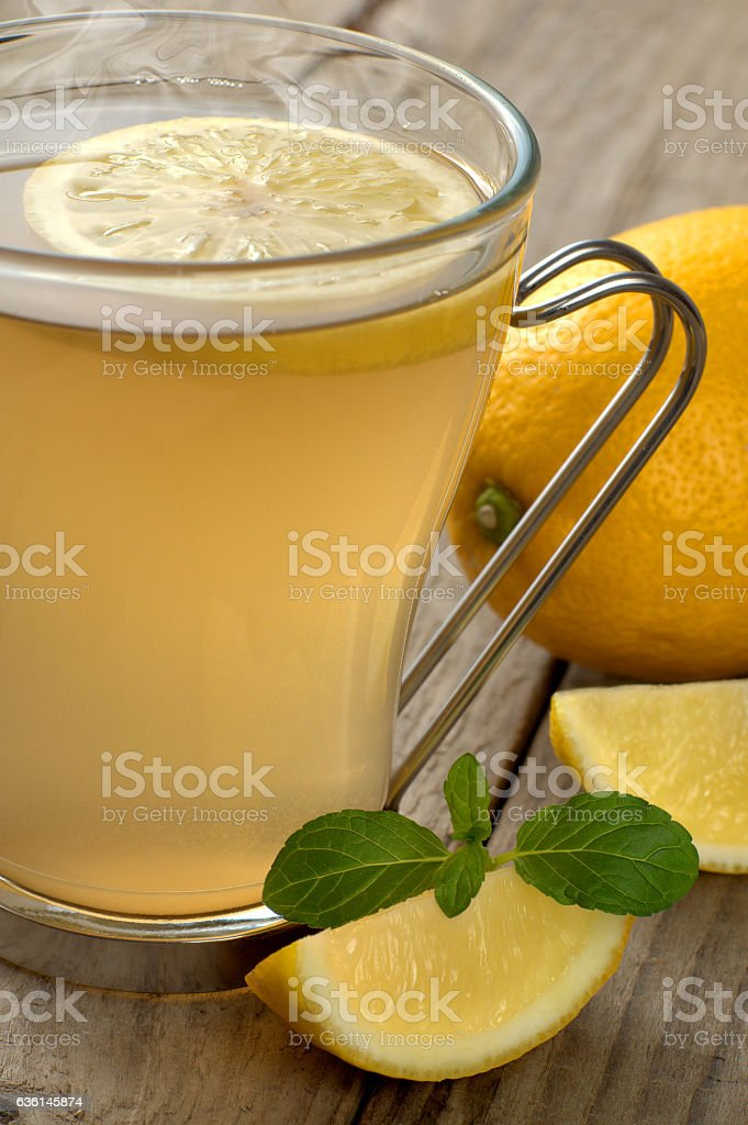 Hot tea with lemon and mint stock photo