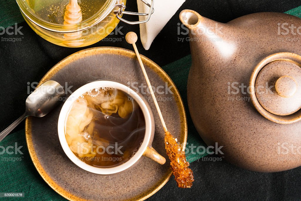 Hot tea with milk stock photo