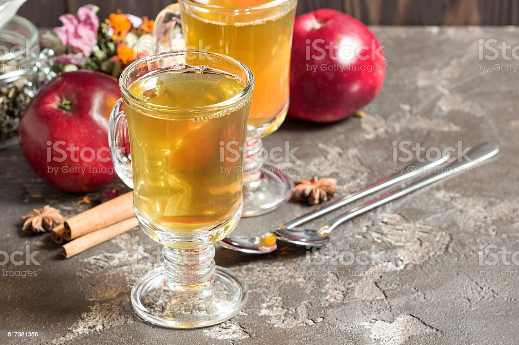 Hot tea with red apples and cinnamon stock photo