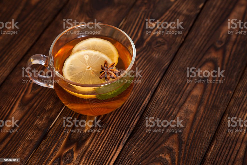 hot tea with spices on a wooden table royalty-free stock photo