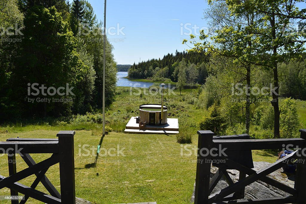 Hot tub in forest by lake royalty-free stock photo