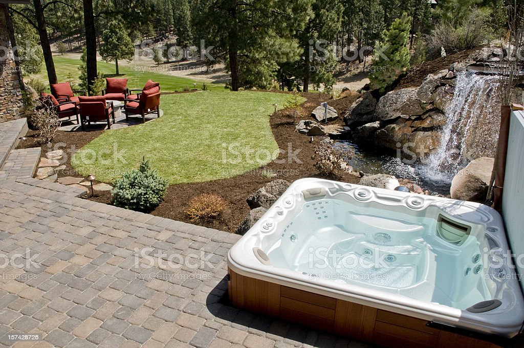 Hot tub with backyard stock photo