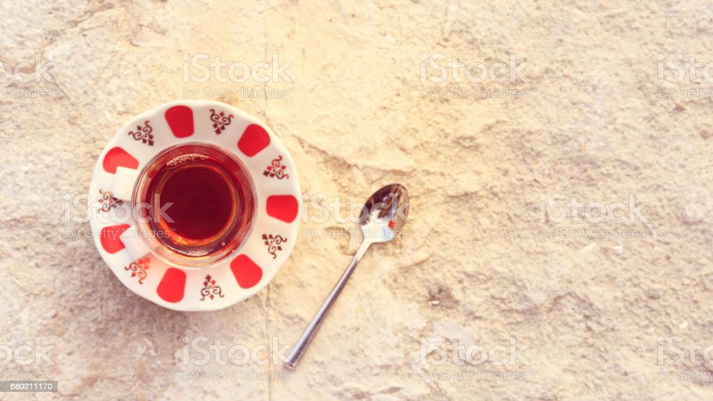 Hot turkish tea outdoors near water. Turkish tea and traditional turkish culture concept stock photo