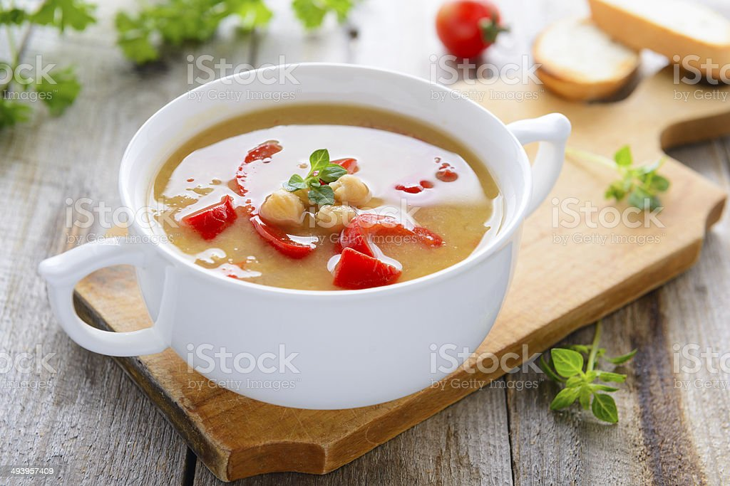 Hot vegetarian soup from chickpeas and lentil stock photo